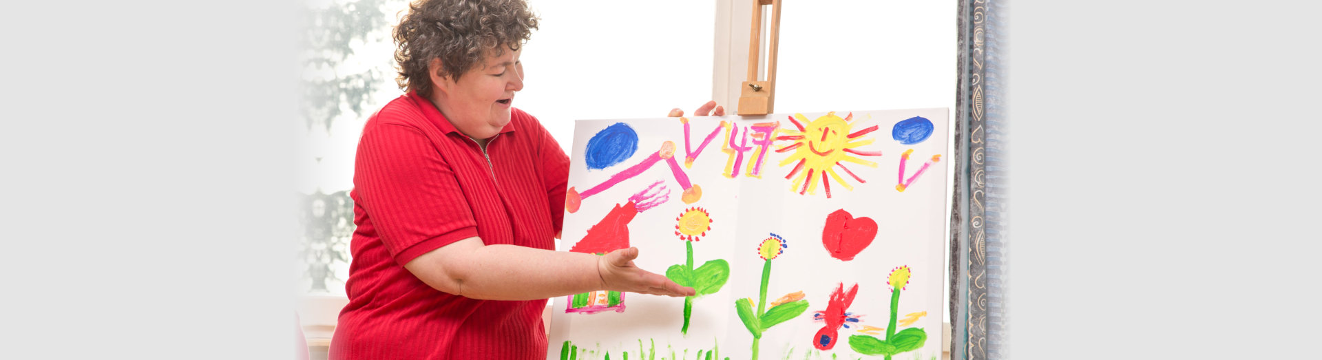 mentally disabled woman showing her painting