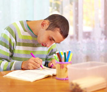 young adult man with special need engages in self study